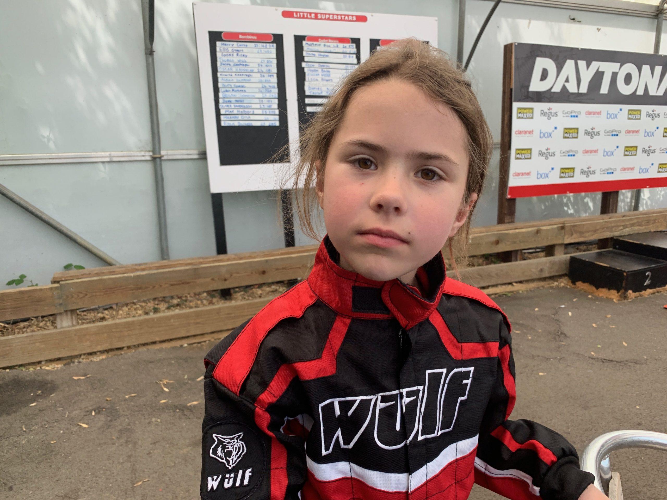 Evie Segebrecht in racing jumpsuit at Daytona
